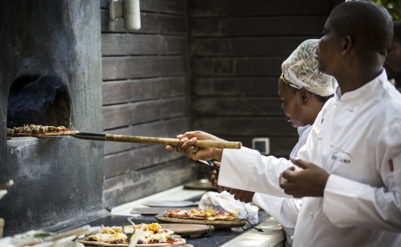 Chefs preparing pizza at Abu Camp, Botswana