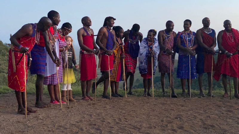Leah joining in the dancing with the Maasai tribe in Kenya